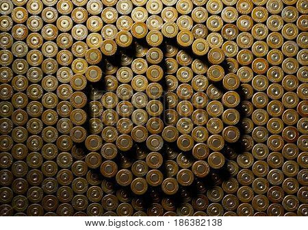 MOSCOW, FEB,14, 2017: Gun pistol bullet round cartridge shell peace pacifist background abstract pattern pacificist symbol relief emboss. Kalashnikov assault rifle gun rounds shells 9 mm caliber