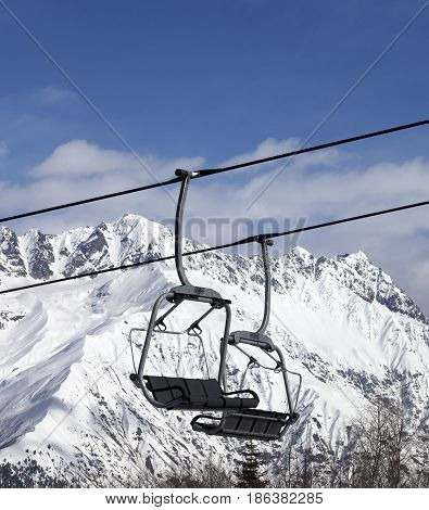 Chair Lift In Snowy Mountains At Nice Sun Day
