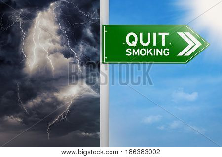Picture of a green signpost to choose quit smoking with blue sky