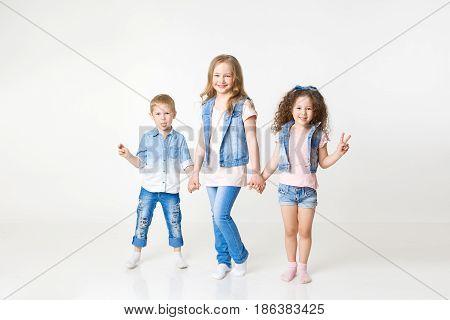 kids in jeans clothes posing in studio.Indoor