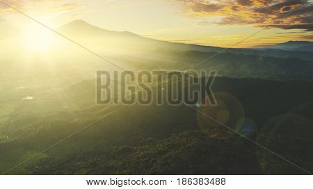 Top view of majestic landscape on the mountain valley in morning time with sunrise. Shot at Majalengka West Java Indonesia
