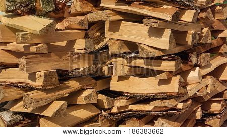 Birch firewood stacked in the woodpile. Texture.