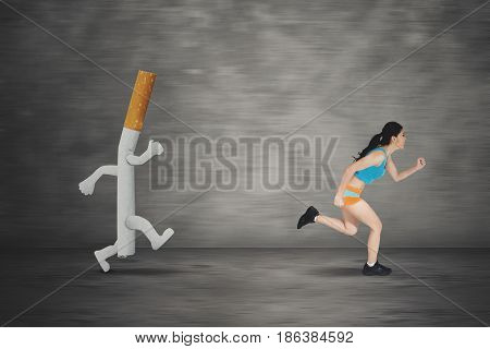 Image of young woman running away by a cigarette with a fast motion blur background