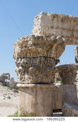 Close up of section of a column with ornately carved capital and lintel or beam. Photographed in Jabal al Qul'a, Amman Citadel, Jordan.
