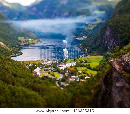 Tilt shift lens - Geiranger fjord, Beautiful Nature Norway. It is a 15-kilometre (9.3 mi) long branch off of the Sunnylvsfjorden, which is a branch off of the Storfjorden (Great Fjord).