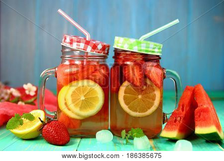 cold  carbonated  berry-citrus lemonade  with  ice  cubes