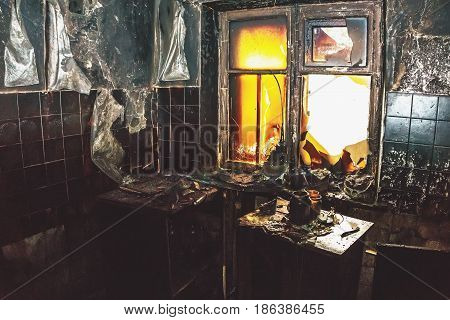 Interior of a burnt room in the house, consequences of a fire