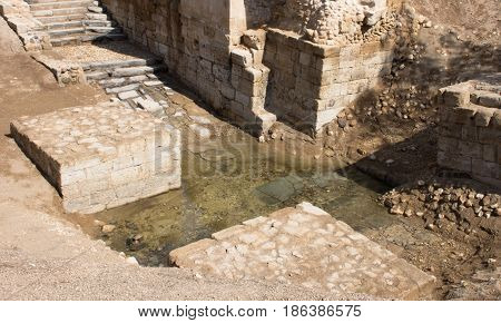 Jordan River Baptismal Site of Jesus Christ at Bethany. The ancient structure is made of stone blocks with stairs leading to small tributary of nearby Jordan River. Photographed from above