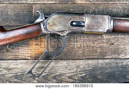 Antique western lever action rifle ready to load bullet.