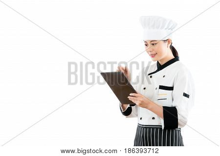 Smiling Asian Woman Chef Using Digital Tablet
