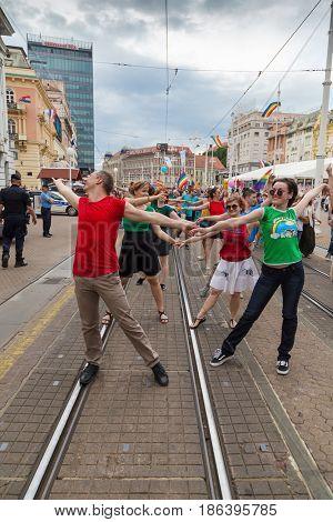 ZAGREB, CROATIA - JUNE 11, 2016: 15th Zagreb pride. LGBTIQ activists dancing at the main square.