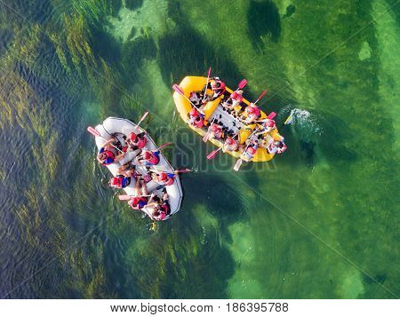 UNA, BOSNIA - AUGUST 30, 2014: Aerial view of people in two raft boats on Una river, Bosnia and Herzegovina.