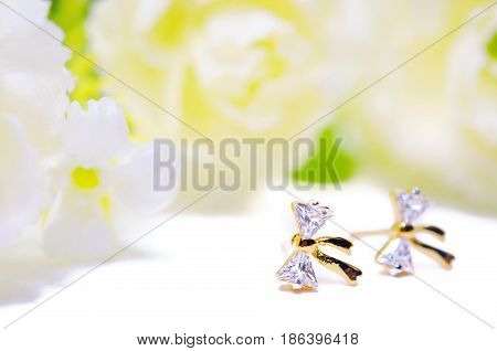 Gold Pendant Cameo Jewelry In Diamond Bow Shape With Flowers Putting Isolated On White
