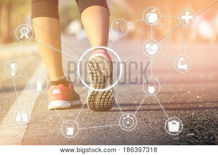Running sport. Woman runner legs and shoes in action on track outdoors at sunset. health icons.