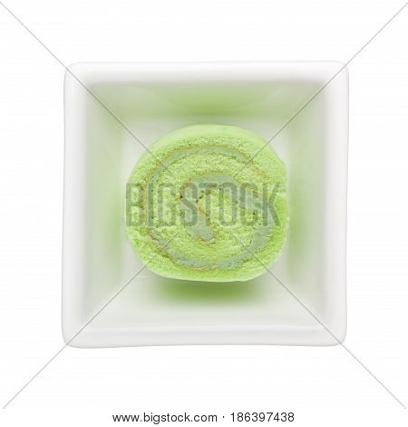 Pandan flavored Swiss roll in a square bowl isolated on white background