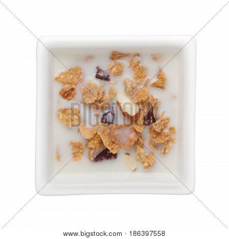 Cornflakes with milk in a square bowl isolated on white background