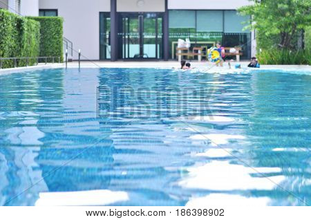 Swimming pool with swimmer pool background blurred