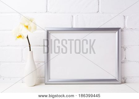 Silver Landscape Frame Mockup With Soft Yellow Orchid In Vase