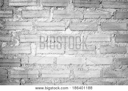 The textured of white brick wall background.