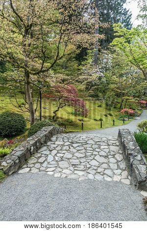 A view of a rock bridge at a garden in Seattle Washington.