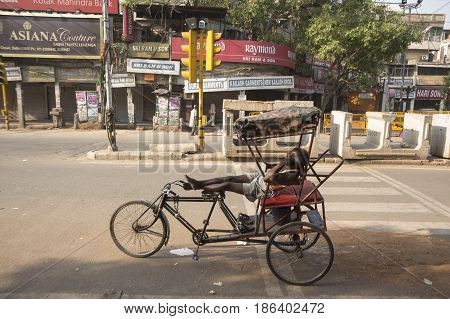 DELHI INDIA-JUN 6 : driver nap in richshaw at chandni chowk rickshaw is three wheeler bike taxi in local area of delhi on june 6 2015 india