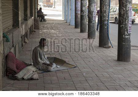 DELHI INDIA-JUN 7 : homeless man live on pavement in Asaf Ali Road near Old Delhi of Delhi on june 7 2015 india.