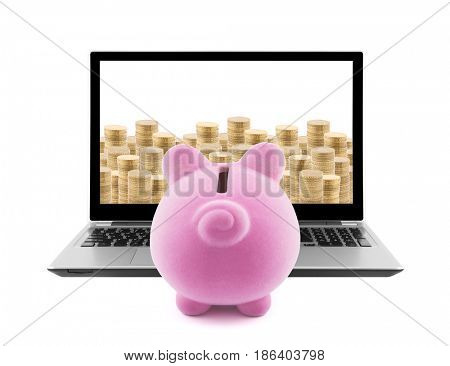 Piggy bank and laptop with stacks of golden coins isolated on white
