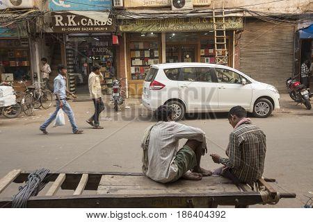 DELHI INDIA - JUN 18 : free time of worker in chawri bazar in old delhi of delhi on june 18 2015 india