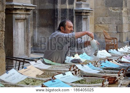 Street vendor selling herbs and spices at the walls of the Cathedral of the Incarnation - Granada, Andalucia, Spain, 27 October 2007