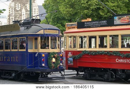 Blue and red vintage trams decorated for Christmas - Christchurch, New Zealand, 11 December 2009
