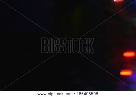 Abstract light streak effect background. Black background with subtle motion light effects.