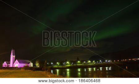 The Northern Light Aurora over Selfoss Kirk Ja Church Iceland