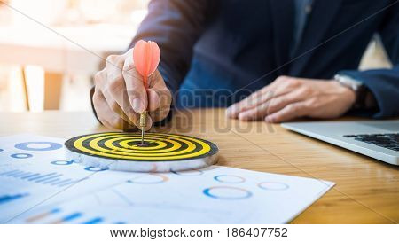 Business man choosing target for success working on his office