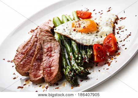 Grilled steak - fillet mignon with asparagus and fried egg