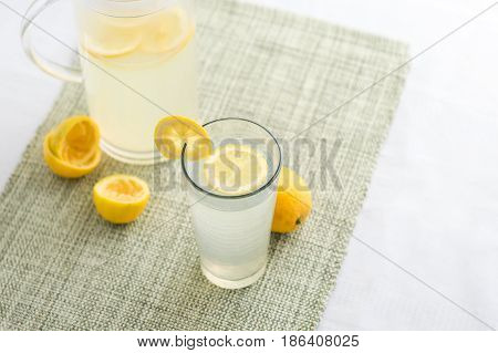 Freshly squeezed lemonade juice glass. Lemonade is traditionally a homemade drink made with squeezed lemon water and sugar a simple recipe for a quick refreshing summer drink packed with vitamin c.