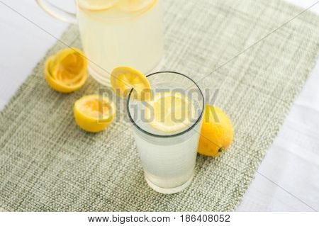 Lemonade juice with lemon slices. Lemonade is traditionally a homemade drink made with squeezed lemon water and sugar a simple recipe for a quick refreshing summer drink packed with vitamin c.