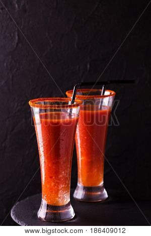 Bloody Mary Cocktail With Chili Pepper, Ice And Celery.