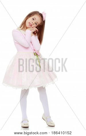 Dressy little girl long blonde hair, beautiful pink dress and a rose in her hair. She holds his palm near his face. Isolated on white background.