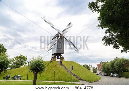 Windmill With People In Brugge