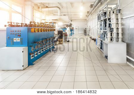 Tinning shop of copper wire. Automatic machines for winding wire on coils.