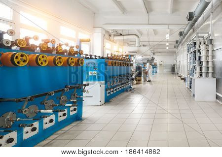 Tinning shop of copper wire. Automatic machines for winding wire on coils. annealing tinned machine