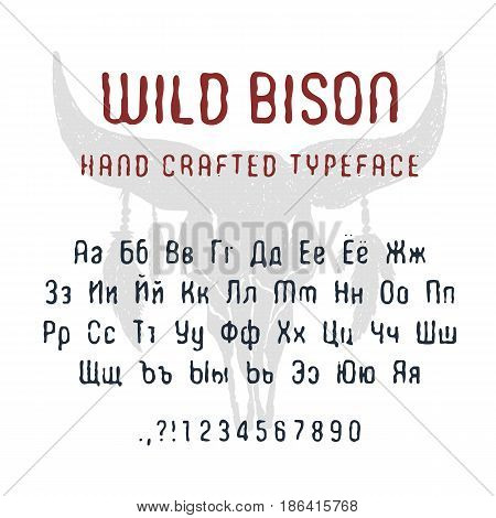 Hand drawn Wild bison font. Cyrillic alphabet vector letters numbers and signs. Buffalo skull with feathers vector illustration.