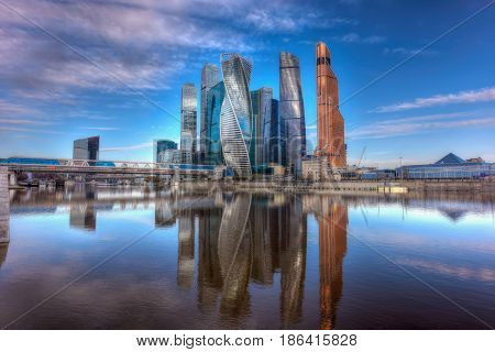 MOSCOW/ RUSSIA - MAY 1, 2017. Moscow International Business Center and pedestrian bridge Bagration on a summer morning. Moscow, Russia