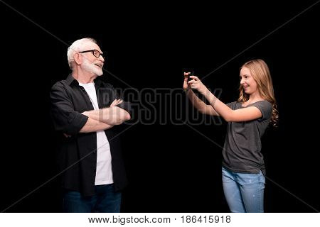 Grandfather And Granddaughter With Smartphone