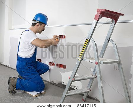 Manual Worker Fixing Electricity Outlet
