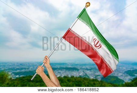 Young man's hands proudly waving the Iran national flag in the sky, part 3D rendering