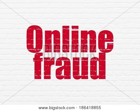 Protection concept: Painted red text Online Fraud on White Brick wall background