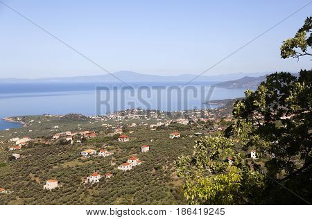 village of stoupa and blue sea seen from the mountains behind it on part of peloponnese called mani in greece