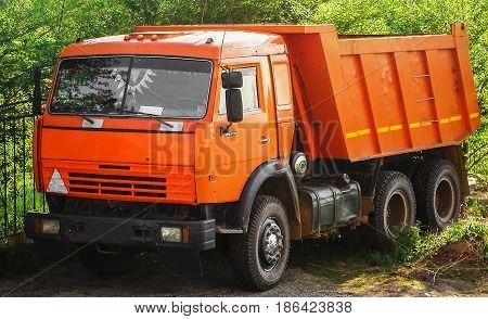 Truck, lorry, orange truck, trucking industry, dumper, tip truck, tip lorry