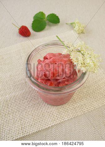 Strawberry and elderflower yogurt ice cream in glass